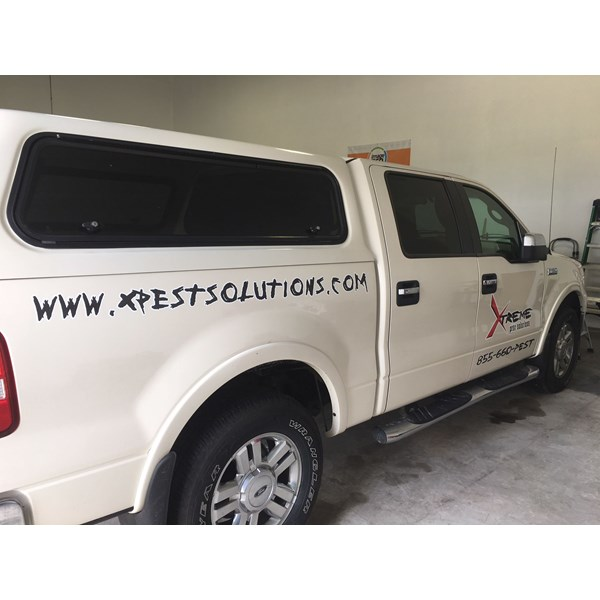 Vehicle graphics, wrap with logo for Xtreme Pest Solutions
